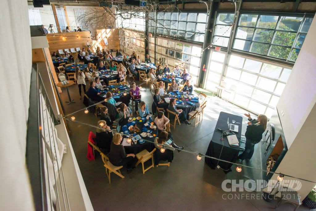 Picture of the 2015 Chopped Conference showing participants seated at round tables, shot from above
