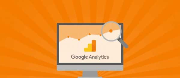 Illustration of a desktop computer with the Google Analytics logo and a bright orange background